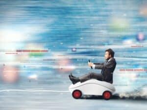 Man speeding through code sitting on a computer mouse